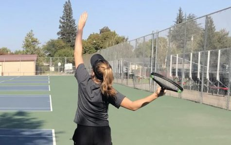 Competitive spirit spurs tennis team