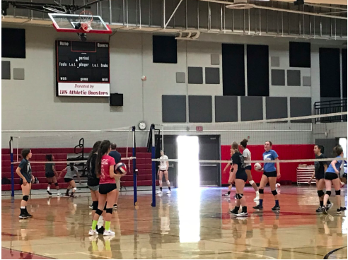 The girls volleyball teams work on hitting and bumping during a recent practice.