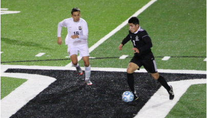 No. 7 Braulio Celis (right) moves the ball past a Merrill West defender during Wednesday's game.