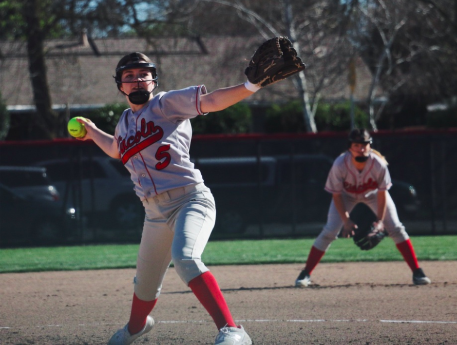 Olivia Riggio tosses a pitch during the Trojans March 11 match against Lodi.